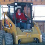 woman in a backhoe